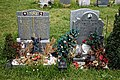 City of London Cemetery modern gravestones 4 plastic Xmas trees and artifacts.jpg