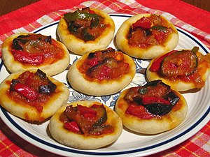 "Coca (pastry) - ""Coca de mullador"", a valencian variety of coca with samfaina, a dish similar to ratatouille, an example of the savoury coca"