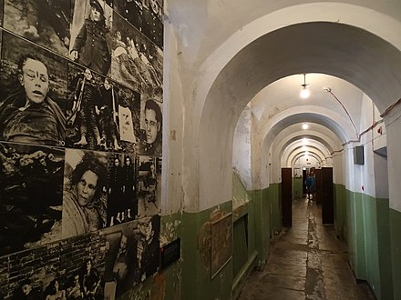 Corridor in the Museum of Occupations and Freedom Fights with display of the Lithuanian partisans killed by the Soviet forces in Lithuania Corridor with Display of Partisans Killed by Soviet Forces - Museum of Genocide Victims - Vilnius - Lithuania (27829872456) (2).jpg