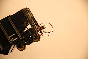 Kadee - a Kadee coupler, mounted on a model hopper car.