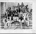 Cricket players, in costume with cricket bats, outside the American Mission High School.jpg