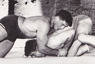 Dale Lewis (wrestler) - Dale Lewis (top) at the 1960 Olympics