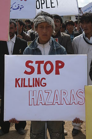 Persecution of Hazara people in Quetta - A boy, in Bamyan, holding placard against the Persecution of Hazara people in Quetta.