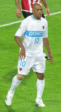A man named Denilson, wearing Pohang Steelers' jersey, during a game against Estudiantes at the 2009 FIFA Club World Cup.