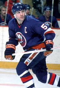"Denis Potvin skating on the ice as the Islanders' captain, sporting the captain ""C"" on his jersey."