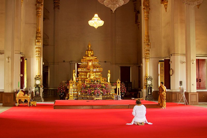 "Photo Credit: Image of ""Devout worshiper at Wat Samphanthawong"" by McKay Savage"