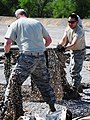 Dirty Details, Airmen demilitarize camouflage netting 140509-F-KA381-003.jpg
