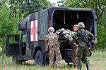 Dog Company trains for medevac in Lithuania 150709-A-FJ979-003.jpg