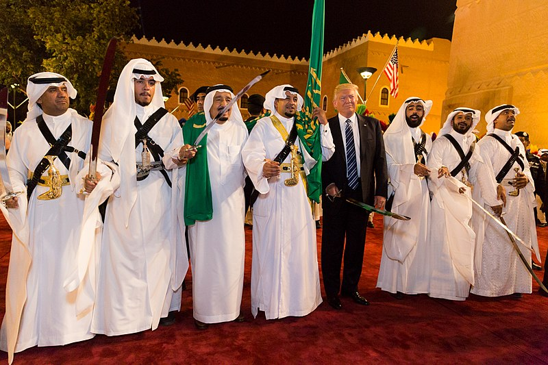 Donald Trump with ceremonial swordsmen on his arrival to Murabba Palace, May 2017.jpg