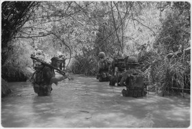 Dong Ha, Vietnam. Operation Hastings - Marines of Company H, 2nd Battalion, 4th Marine Regiment take to the water as... - NARA - 532443.tif