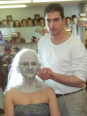 Theatrical makeup - Make-up artist Dubi Preger finishing a make-up design.