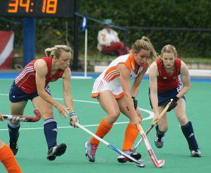 2009 Women's Hockey Champions Trophy - Dutch player Ellen Hoog shielding the ball during Netherlands-England match on 11 July 2009.