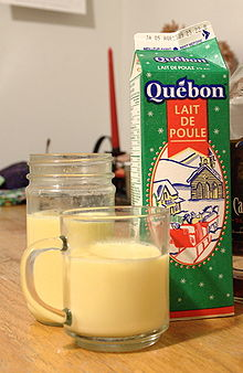 carton and a glass of eggnog from Montreal, Canada , showing its ...