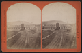 Erie Railroad yard showing round house, watertower and switching yard, by W. L. Sutton.png