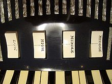 Set of two-way rocker switches (labeled LOW, HIGH, MIDDLE, MIDDLE) controlling individual reed ranks for the treble keyboard of an Excelsior accordion.
