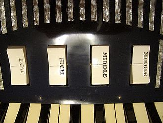 Accordion reed ranks and switches - Image: Excelsior 00 accordion rocker switches detail