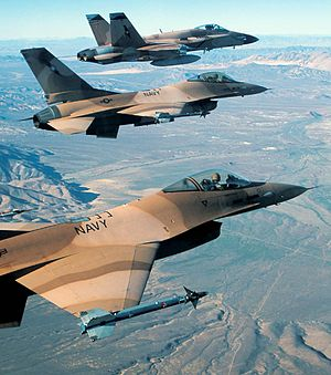 Naval Strike and Air Warfare Center - NSAWC F-16As and an F/A-18A over Nevada, in 2005.