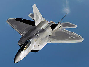 An F-22 Raptor flies over Kadena Air Base, Japan on a routine training mission in 2009.