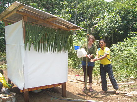 A tippy tap for handwashing after using a urine-diverting dry toilet in Pumpuentsa, Ecuador Finished UDDT in Pumpuentsa (5630907486).jpg