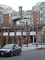 Firefighters service a ladder truck outside fire hall 333, Toronto, 2014 05 20 (2) (14258189834).jpg