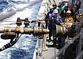Flickr - Official U.S. Navy Imagery - Sailors guide in a fuel hose during a replenishment-at-sea..jpg