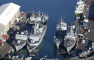 Naval base - A French flotilla in Réunion: (from left) the patrol ship Albatros, frigate Floréal, P400 La Rieuse and La Boudeuse, Gendarmerie Navale's Jonquille, BATRAL La Grandière and the Garonne, behind an oiler, and the swift boat Vétiver (outside the water).
