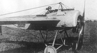 "Fokker Eindecker fighters - A Fokker E.II of late 1915, with the ""dragged"" engine turning visible on the engine cowl and associated sheet metal."