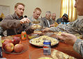 Foreigners from a PRT and Afhghans share an Eid meal.jpg