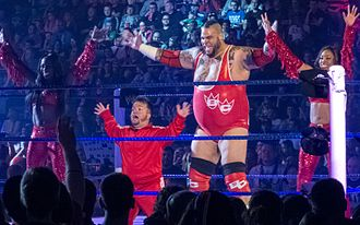 Cameron (wrestler) - Cameron (right) at the ring along Brodus Clay, dance partner Naomi, and Hornswoggle (front) in April 2012