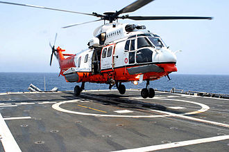 Government Flying Service - A GFS Super Puma landing on the deck of the USS Mobile Bay, April 2006