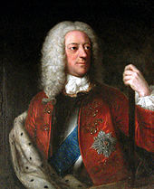 A half-length colour portrait of a man wearing a long wig. Various emblems are apparent on his jacket, and his left hand holds a pole.