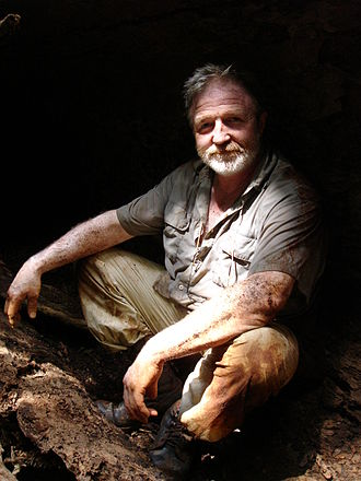 George McGavin - McGavin in a hollowed-out log in Borneo