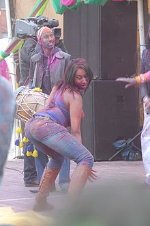 A woman twerking at a music festival.