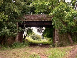 Ledbury and Gloucester Railway - A bridge carrying a minor road over the railway trackbed near Rudford church.