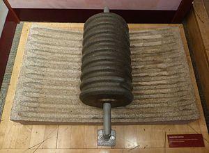 Conche - Granite roller and granite base of a conche