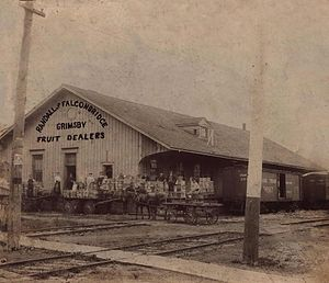 Grimsby GO Station - The original Great Western Railway station in Grimsby, built in 1853 and seen here when used by Randall and Falconbridge Fruit Dealers circa 1908. The station is protected by the Ontario Heritage Act.