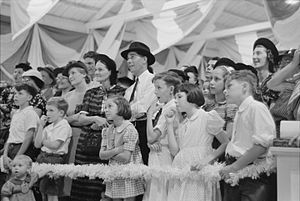 Donaldsonville, Louisiana - An audience watches a magician perform at the Louisiana State Fair in Donaldsonville (1938)