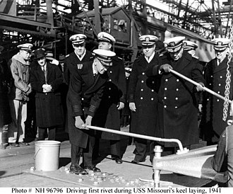 "Keel laying - Driving the first or ""golden"" rivet during USS Missouri's keel laying, 1941"