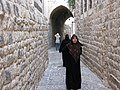 Hama, Stone alleys of the old city of Hama, Women in hijab and niqab, Syria.jpg