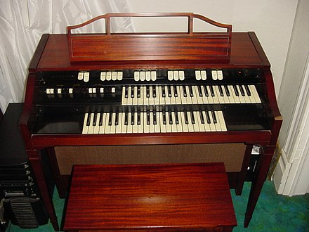 The L-100 spinet was particularly popular in the UK. Hammond L-112.jpg