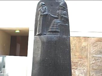 Detail from Hammurabi's stele shows him receiving the laws of Babylon from the seated sun deity. Hammurabi.jpg