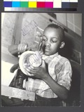 Harlem Community Art Center- student in metal craft class, 290 Lenox Avenue, Manhattan (NYPL b13668355-482613).tiff