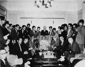 Hatoyama Hall - Prime Minister Ichirō Hatoyama (center) and the leaders of the ruling LDP, including Tanzan Ishibashi (to the left of Hatoyama) and Bukichi Miki (second to the right of Hatoyama), along with the press. The group photo was taken in the salon of the Otowa Mansion sometime during 1955.
