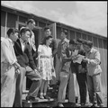 Heart Mountain Relocation Center, Heart Mountain, Wyoming. A group of students gathers around the e . . . - NARA - 537154.tif
