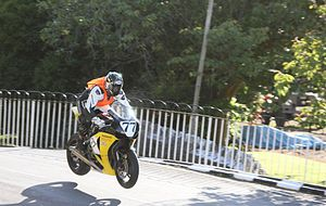 Ballaugh Bridge - Herve Gantner wearing a rookie orange high-visibility vest jumping from Ballaugh Bridge in 2010