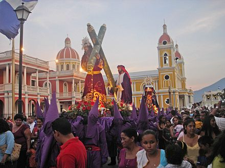 Lent celebrants carrying out a street procession during Holy Week, in Granada, Nicaragua. The violet color is often associated with penance and detachment. Similar Christian penitential practice is seen in other Christian countries, sometimes associated with fasting. Holy Week procession in Granada, Nicaragua.jpg