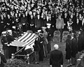Honor Guard prepares to fold flag over JFK casket, 25 November 1963.jpg