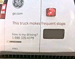 """How's my driving?"" sign - A white van with a how's my driving sign"