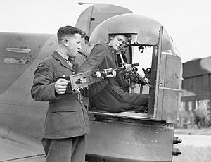 Armstrong Whitworth Whitley - A Browning machine gun being installed in a Whitley's turret, 1940