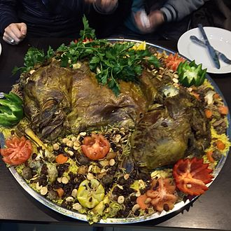 Iraqi cuisine - Quzi, a dish originating in Iraq, eaten throughout the Arab world, and the Middle East